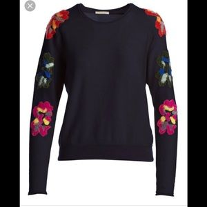 Chloe wool-blend sweater with Flowers embroidery.